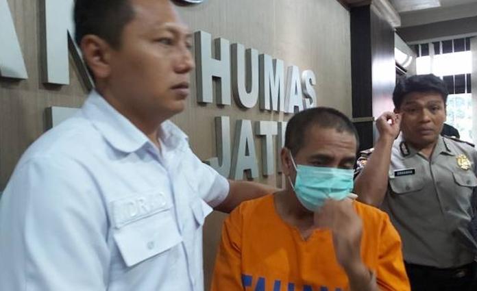 Mantan Ketua PSSI Kota Pasuruan 2015-2019, Edy Heri Respati saat ditahan di Mapolda Jatim